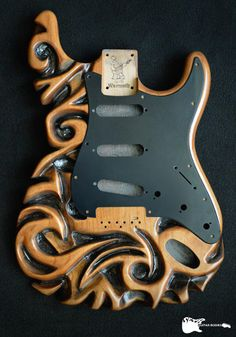 """A hand-carved Warmoth Guitar Products S-style body made of alder, aptly named the """"Tattoocaster."""