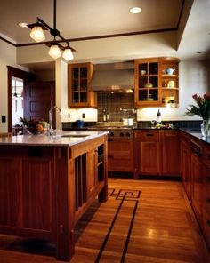 I adore everything about this...the Craftsman style, great wood, perfect tiling, even the pot filler over the range...perfect!