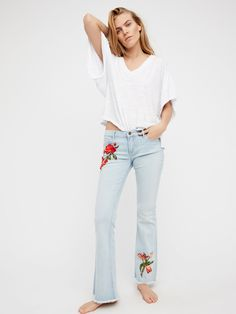 Eva Embroidered Flare | These low-rise flares beautiful and colorful floral embroidery detailing.    * Slightly stretchy denim    * Raw hem   * Five-pocket style   * Button closure and zip fly
