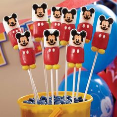 Mickey Mouse Marshmallow Pops How-To from @partycity. Make Mickey treats that will look adorable on your dessert table! Marshmallows dipped in Candy Melts® candy and decorated with candy trims make these a quick and easy idea. Just stick the pops in a craft foam block and let kids grab their own!