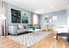 Light blue and grey living room with wooden futon | Decolover.net