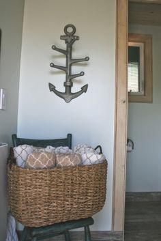 Pottery Barn anchor hook for nautical wall decor.