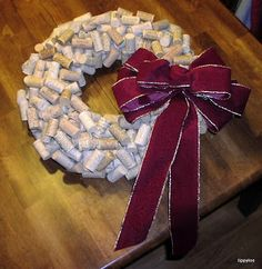 Wreath made from wine corks (wouldn't take very long to collect those) but I would use that other pinned idea of the insulation for pipes at the hardware store to make the base of the wreath