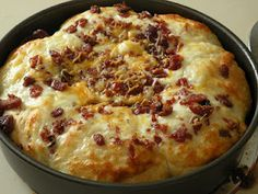 Cheesy Bacon Pull-Apart Bread.  You can also use frozen bread dough (the rolls version).  Grease the pan, place the frozen dough in the pan, put the other ingredients on top.  Put in cold oven the night before.  In the morning, take it out of the oven, turn on oven to temperature in recipe & bake as directed.