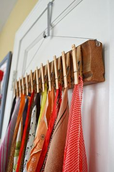 Make a lovely scarf display by gluing clothespins to a pretty board and hanging on your wall or door