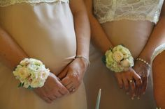 The Bridesmaid's were wearing beautiful Wrist Corsages of Bombastic & 4 Good Roses with Rolled Menta Rose Petals and Hydrangea Florets