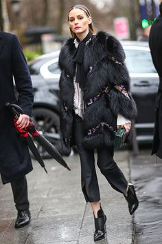 Olivia Palermo wears a black fur coat outside the Giambattista Valli show during Paris Fashion Week Womenswear Fall/Winter 2017/2018 on March 6 2017...
