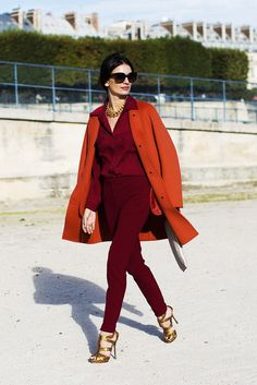 tangerine wool coat over a red suit. Outfit perfection!