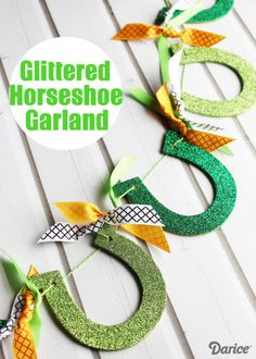 Invite some luck o' the Irish into your home this St. Patrick's Day by making a horseshoe DIY garland that sparkles & shines! It's easy & oh-so-fun to make!