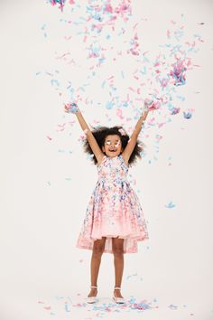 Confetti and pretty dresses makes for a picture perfect flower girl.