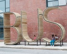 "bus-2 >  The ingenious stop is comprised of three 14′ typographic sculptures that literally spell out the word ""BUS"" while functioning as benches and a novel leisure space. The bus stop was unveiled last month by artist collective mmmm…, a creative collaboration between Emilio Alarcón, Alberto Alarcón, Ciro Márquez, and Eva Salmerón, who have been designing public spaces in Madrid since 1998. This is their second project in the United States. Via the collective's website:"