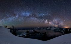 Lyrids meteor showers over Crater Lake, Oregon with the lovely Milky Way arching across the night sky.