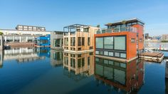 Modern floating homes in Amsterdam's IJburg neighborhood, a trio of artificial islands created to help mitigate the city's housing shortage.
