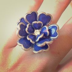 Navy and Silver Flower Ring A statement ring! Silver and Navy blue flower. Elastic. Perfect condition. Charming Charlie Jewelry Rings