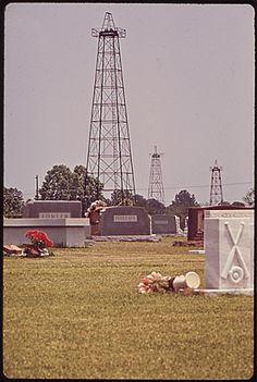 An oil derrick in a cemetery in Kilgore, Texas, 1973.