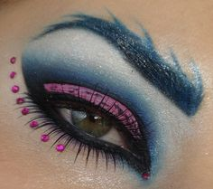 Glam blue and pink smokey eye with blue brow and purple jewel accents.