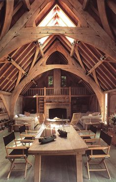 The Seagull House, a barn conversion, features oak frames with arch-braced collar trusses. The studio, and the conservatory overlooking the creek, are done in Douglas fir. Verandas, balconies and timber cladding complete the exterior. Designed by Roderick James as his family home, it was converted in Devon, England in 1987