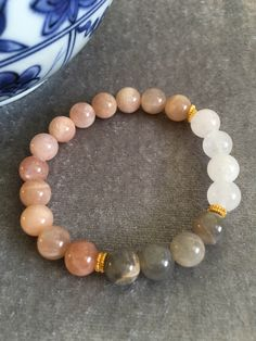 A personal favorite from my Etsy shop https://www.etsy.com/listing/489545441/moonstone-snow-quartz-and-gold-beaded