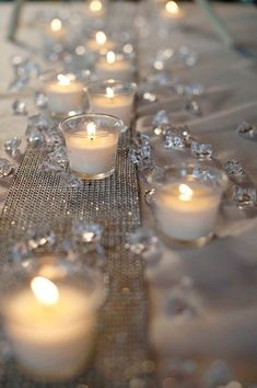 Neat White table cloths with gold runner and tealights and diamond or gold glitter candle scatters. Pretty and simple and inexpensive. The post White table cloths with gold runner and tealights and diamond or gold glitter ca… appeared first on 99 Decor . Wedding Centerpieces, Wedding Table, Diy Wedding, Wedding Events, Wedding Flowers, Trendy Wedding, Candle Centerpieces, Wedding Ideas, Centerpiece Ideas