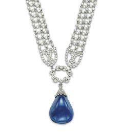 A BELLE EPOQUE SAPPHIRE, PEARL AND DIAMOND NECKLACE   The seed pearl mesh band gathered at the front by a diamond wreath link, suspending a detachable cabochon drop-shaped sapphire with diamond cap, to the diamond-set clasp, 1910s, 34.5 cm  Pendant signed Cartier Paris, no. C7425