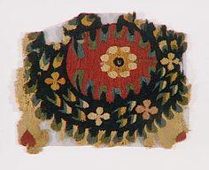 Tissu copte : couronne de laurier fleurie polychrome, 6e siecle, Egypte
