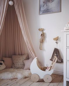What a cosy play space. A canopy works just as well to create a little reading/ playing corner as it does over a cot or bed. Just add… Nursery Paint Colors, Nursery Neutral, Neutral Nurseries, Pink Curtains Nursery, Nursery Reading, Play Corner, Girl Room, Girl Nursery, Nursery Ideas