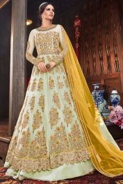 Light Pastel Green Net Fabric Heavy Anarkali Style Dress With Yellow Dupatta #Fabja #gowns #fashion #weddinggown #partyweargown #gown #gowndesigner #gownstyle #salwarsuitonline #designersuits #anarkalisuitsonline #longanarkali #longanarkali #anarkalisuit #salwarsuit #designersalwarsuit #anarkalisalwarsuit #anarkalidress #receptiondress #salwarkameez #suit #sale #love