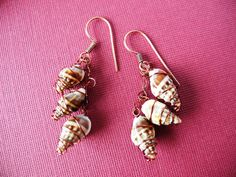Tiny shells wrapped in wire. $10.00, via Etsy.