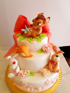 Elegant animal forest cake. Would be cute for a baby shower or first birthday cake!