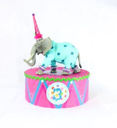"""Circus Animal Stand- Large """"Pink"""" by PaintedParade on Etsy, $25.00. Fun table decoration, with animal propped on top. Or in lieu of a cake topper, if using cupcakes, or ice cream. Has a customizable age on the front, and can be made to match party colors."""