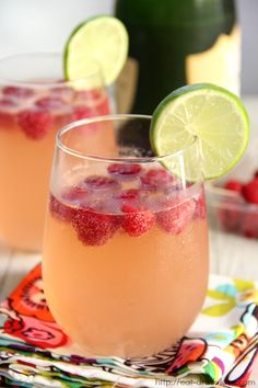 Raspberry Lemonade Champagne Punch. Raspberry lemonade, champs, vodka, frozen raspberries and lime wedge