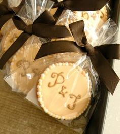 piped initials with ribbons cookie wedding favors