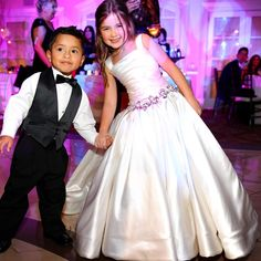 In love with this #PninaTornai #FlowerGirl gown. How sweet is this #RingBearer holding hands with our our #PninaPrincess Jordan ?  Photography by: @miltongilphotographers