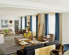 At home with Nate Berkus in Chicago - Elle Decor When there is no room for a sofa table behind the sofa, add a tapestry/rug/blanket to the back.