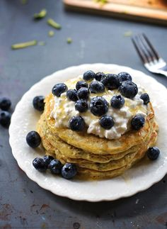 ZUCCHINI PANCAKES topped with cottage cheese and blueberries and honey.