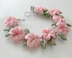 Pink Plumeria Garden Bracelet  Polymer Clay by beadscraftz on Etsy, $60.00