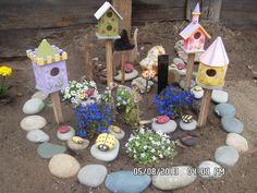 Ladybug Garden..got bird houses from Michaels and painted them...then painted pebbles to look like lady bugs...