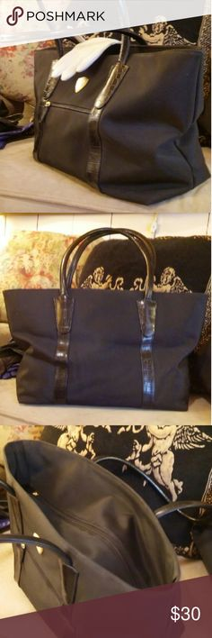 "Blaine Trump black canvas Great large tote with zip closure & gold tone accents.  Red interior is clean. Outside is in good used condition.  Bottom has gold tone "" feet"" to protect bottom.  One outside zip pocket at front. Soft Faux leather snake skin embossed handles.  Impressive. Blaine Trump Bags Totes"