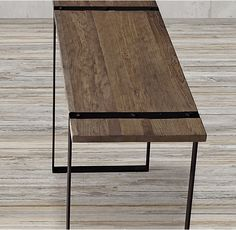 RH's Industrial Metal Strap & Elm Console Table:Contrasting materials combine and complement in our 21st century table – an industrial style seen through a modernist lens. The planked elm top is supported within two open, metal-strap rectangles and held by oversized rivets.