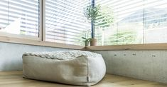 Natural materials and large glass surfaces characterize the design of this house, which perfectly blends into its natuaral surroundings. You can find nature outside and inside. Natural Materials, Bean Bag Chair, Surface, Sofa, Windows, Glass, Nature, Design, House