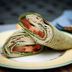 Cheesy Chicken Wrap -- 1 spinach tortilla, 1 laughing cow sun dried tomato cheese wedge, sliced deli meat, tomato slices, fresh spinach leaves, any other fresh veggie