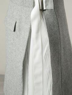 Shop Sacai wrap skirt.