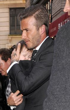 David Beckham just got sexier than ever. Love a man who loves his children