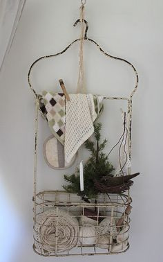 ♥.  Do the shabby treatment to my hooked organizer, to look like this, hooked on a wire hanger.