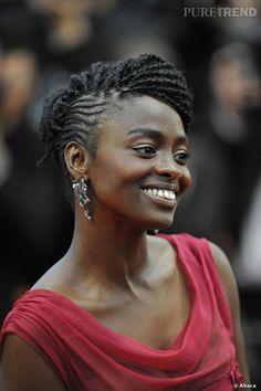 """Pour la première du film """"Amour"""", Aissa Maiga portait les boucles d'oreilles """"Fronde"""" de chez Damiani, en or blanc et noir, serties de diamants et rubis."""
