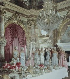 Preservation ladies gathering in the dining room of The Breakers dressed in white powdered whigs for a costume ball. Second from left is Katherine Warren, founder of the Preservation Society of Newport.