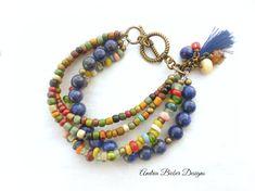 handmade jewelry, jewellery by Andria Bieber.  https://www.andriabieberdesigns.com/ Bohemian, multi strand bracelet, Indonesian glass, tassel, Lapis Lazuli stone, bronze metal.