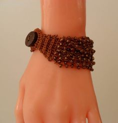 Brown Crochet Bead Bracelet SwedishShop, $15.90  I got a green one in Venice at a rummage sale for about a buck.