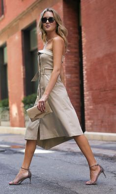 Khaki fit and flare midi dress with asymmetrical hem + snakeskin strappy sandals, gold clutch and wavy hairstyle {Banana Republic}