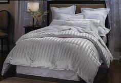 LUXURIOUS 1000 Thread Count King / California King 1000TC Goose Down Comforter 750FP, 50oz, White Stripe 1000 TC, 100% Egyptian Cotton Bedding Warehouse http://www.amazon.ca/dp/B002UKIG7M/ref=cm_sw_r_pi_dp_Usukwb0RYQF06